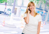 Happy woman talking on a mobile — Stock Photo