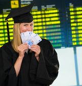 Graduate woman holding euro notes — Stock Photo