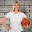 Happy Woman Holding a basket ball - Stock Photo