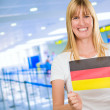 Woman holding a german flag — Stock Photo