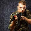 Portrait Of A Soldier Aiming With Gun — Stock Photo