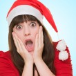 Stock Photo: Scared woman wearing a christmas hat