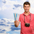 Man holding boarding pass and airplane — Stock Photo #14855741