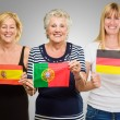 Three Woman Holding Different Flag — Stock Photo