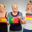 Royalty-Free Stock Photo: Three Woman Holding Different Flag