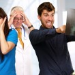 Young Couple Watching X-ray In Front On Frustrated Doctor - Stock Photo