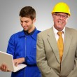 Stock Photo: Engineers Smiling Infront Of Architect Using Laptop