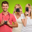 Happy Family Holding Camera - Stock Photo