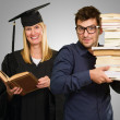 Two Young Students Holding Book — Stock Photo #14856427