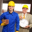 Stock Photo: Portrait Of Two Architect Engineers Holding Clock And Brick