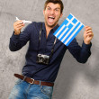 Man holding flag and miniature airplane  — Stockfoto
