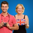 Man Holding Camera In Front Of Woman Holding British Flag — Stockfoto