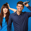 Man Cutting His Hair With Razor In Front Of Scared Woman - Stock Photo