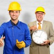 Architect Gesturing In Front Of Engineer Holding Clock — Stock Photo