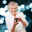Senior woman using cellphone — Stock Photo
