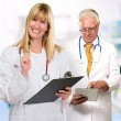 Two Happy Doctors While Holding Clipboard, Tablet — Stock Photo