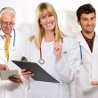 Happy Female Doctor Holding Clipboard Infront Of Male Doctor — Stock Photo #14859603