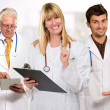 Happy Female Doctor Holding Clipboard Infront Of Male Doctor — Stock Photo