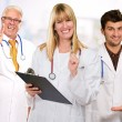 Happy Female Doctor Holding Clipboard Infront Of Happy Male Doct - Stock Photo