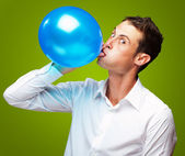 Portrait Of Young Man Blowing Balloon — Stock Photo