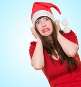 Scared woman wearing a christmas hat — Stock Photo