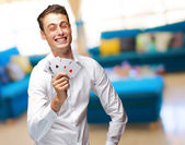 Portrait Of Young Man Showing Poker Cards — Stock Photo