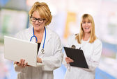 Portrait Of Two Happy Female Doctors — Stock Photo