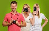 Happy Family Holding Camera — Stock Photo