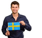 Potrait of a man holding flag — Stock Photo