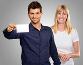 Man Hand Holding Blank Placard And Happy Woman Standing Behind — Stock Photo