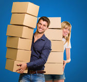 Young Couple Holding Cardboard Box — Stock Photo