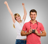Man Holding Camera In Front Of Dancing Woman — Stock Photo