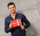 Potrait of a young man holding flag — Stock Photo