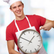 Portrait Of A Young Man Holding A Clock — Stock Photo #14860341