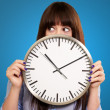 A Young Girl Holding A Clock — Stock Photo #14861653