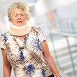 A Senior Woman Wearing A Neckbrace - Stock Photo