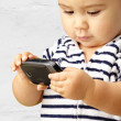 Portrait Of Baby Boy Using Cell Phone — Stock Photo #14864185