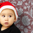 Baby Boy Wearing Santa Hat Holding Christmas Ornaments — Stock Photo #14864493