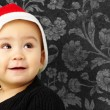 Baby boy wearing a christmas hat and looking up — Stock Photo #14864501