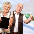Happy Senior Couple Holding Digital Tablet — Stockfoto