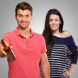 Young Man Holding Alcoholic Bottle In Front Of Happy Woman — Stockfoto