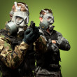 Stock Photo: Portrait Of Soldiers With Gun And Gas Mask