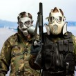 Portrait Of Soldiers With Gun And Gas Mask — Stock Photo