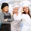 Three Happy Female Chef Gesturing — Stock Photo #14867119