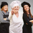 Three Happy Female Chef Gesturing - Stock Photo