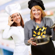Royalty-Free Stock Photo: Female Chef\'s Happy With Their Food