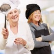 Portrait Of Two Female Chef - Stock Photo