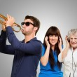 Young MBlowing Trumpet And Women Getting Irritation Wearing — Stock Photo #14867201