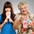 Mother And Daughter With Pop Corn, Ticket And 3d Glass — Stock Photo