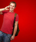 Man holding mobile and backpack — Stock Photo